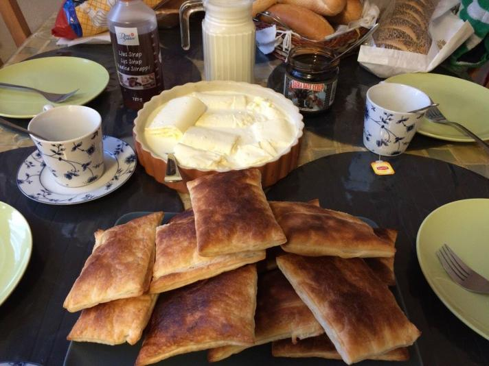 Qaimar (as prepared by Hajer Mohsen) served alongside pastry and syrup. Photographer: Aiya Mohsen.