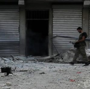 Free_Syrian_Army_soldier_walking_among_rubble_in_Aleppo_s