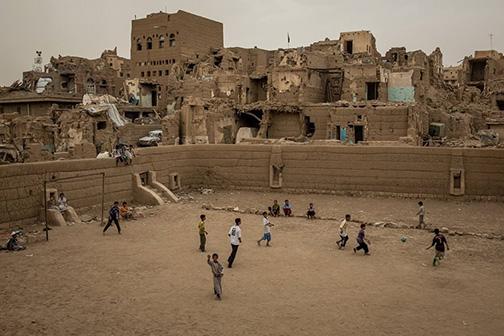 Yemeni children playing football in the rubble of Sa'da.
