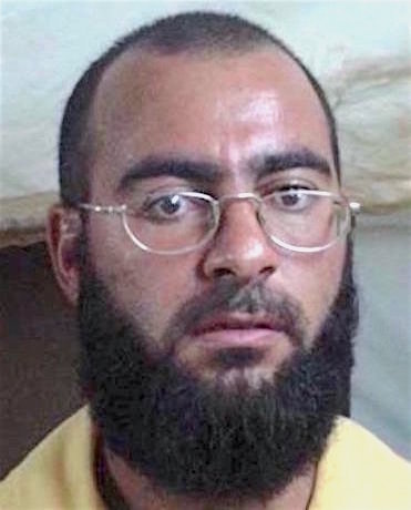 Mugshot of Abu Bakr al-Baghdadi taken by US armed forces while in detention at Camp Bucca in the vicinity of Umm Qasr, Iraq, in 2004.