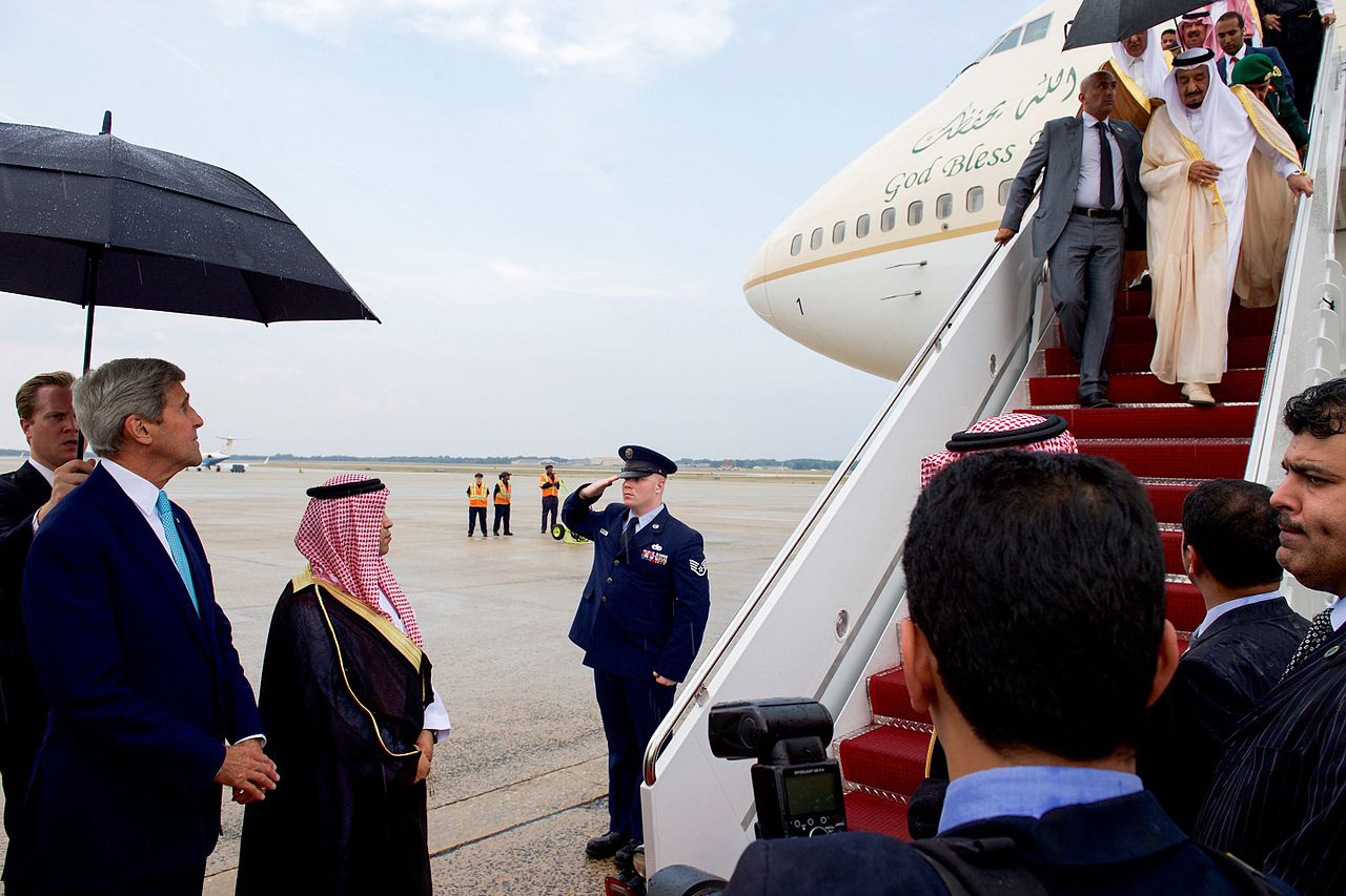 U.S. Secretary of State John Kerry waits at the bottom of the stairs as King Salman bin Abdulaziz of Saudi Arabia deplanes from his Boeing 747 after arriving at Andrews Air Force Base in Camp Springs, Maryland, on September 3, 2015, to visit President Barack Obama (photo: State Department / Public Domain).