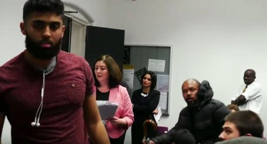 Screenshot from the recorded talk. To the left is one of the provocateurs, behind him is Maryam Namazie.
